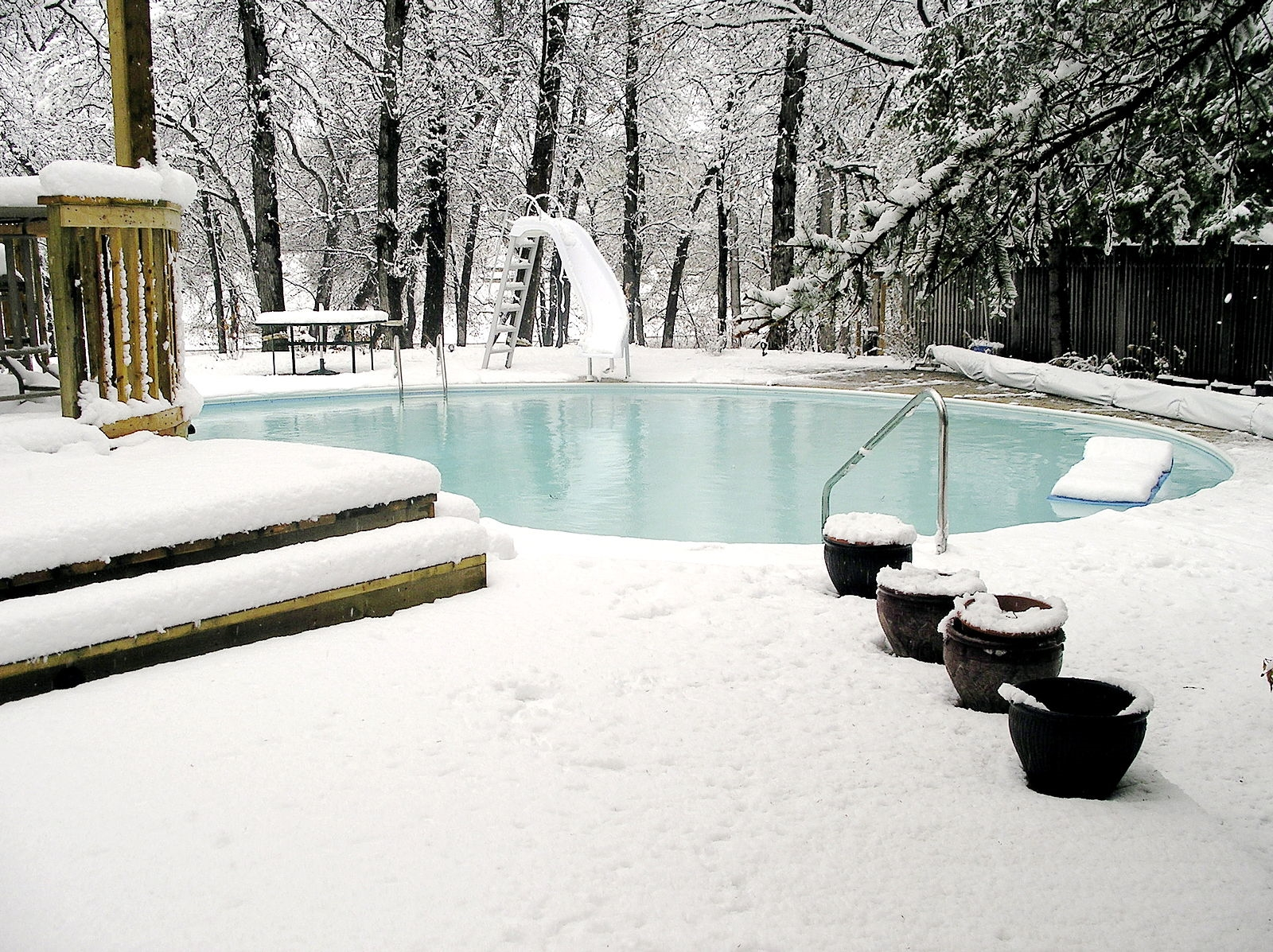 Snow Covered Pool Patio
